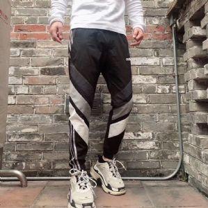 阿迪达斯薄款运动裤女情侣宽松撞色拼接休闲长裤